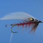 Red Hot Streamer Haczyk 2-4 x long, 8-2 Ogonek, tułów, jeżynka tułowia, owijka – jw. Skrzydełka – dwie pary białych siodłowych piór koguta Jeżynka przednia – Kura badger brązowa Ramiona – Jungle cock