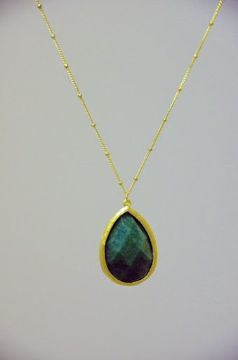 The multitude of colors in this single emerald stone are fascinating. (www.reddressboutique.com)