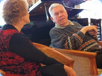 Sandi Crawford talking to Jim Nicholson. Jim played the grand piano during the lunch break. Photo courtesy of Dennis Lyons