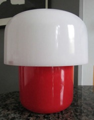 red and white Guzzini lamp
