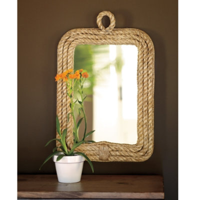This mirror would be perfect over your entryway table. It has a sophisticated shape, with a more relaxed look with the rope.  (ballarddesigns.com)