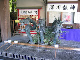 A triple dragon head water spout at Fukagawa Fudoson temple, for cleaning your hands before praying