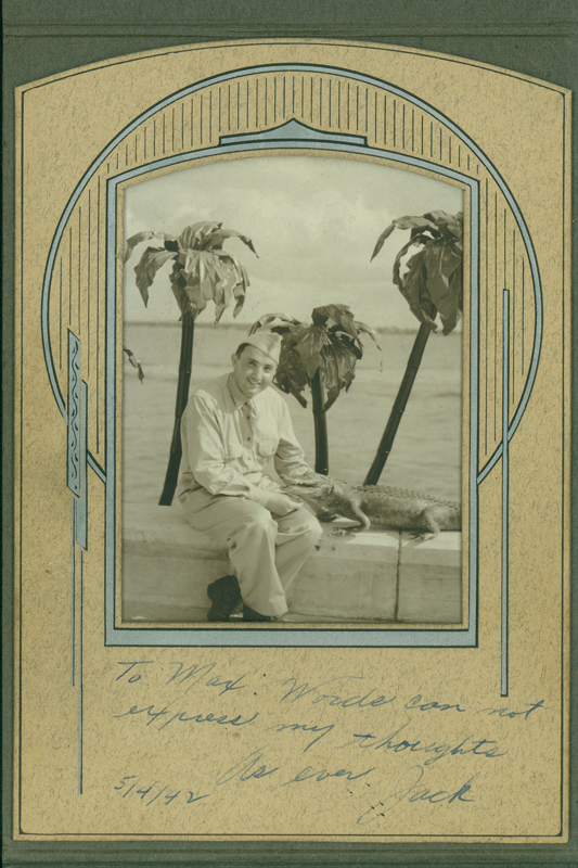 "Jack Bloch sent this photograph of himself and an alligator from his Naval post to Max Gundy with a note that reads: ""To Max: Words can not express my thoughts. As ever, Jack."""