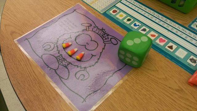 http://www.teacherspayteachers.com/Product/Monster-Teeth-Roll-and-Count-1479299