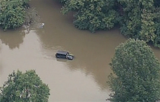 Aerial view of a car stranded in floodwaters in Louisville, Kentucky, 6 October 2013. Photo: WAVE