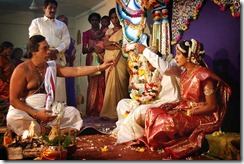 Brahman hindu priest bleses a young couple in the hindu temle of Chavakachcheri during traditional hindu wedding on 20. November 2005, Chavakachcheri, Jaffna Sri Lanka