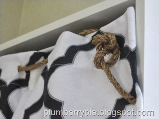 rope and shower curtain as hidden toy storage - plumberry pie