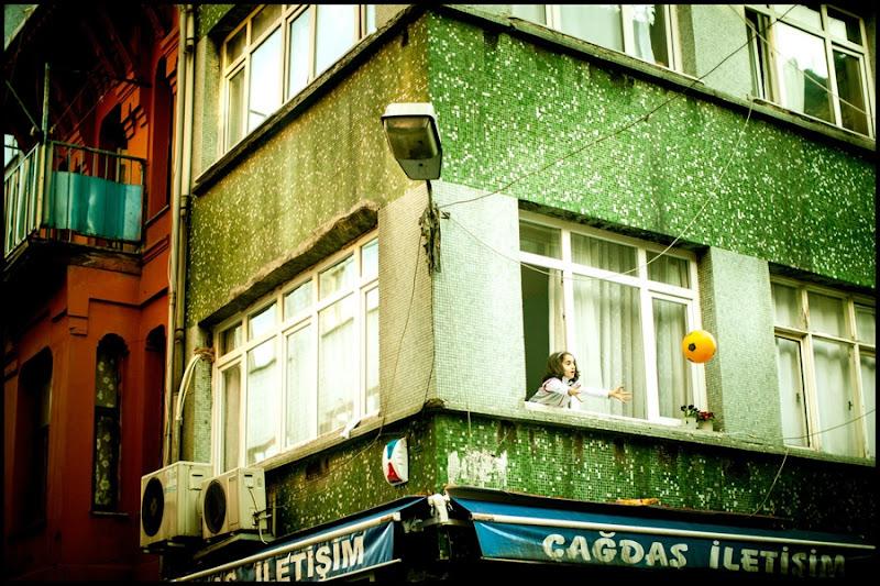 child with ball apartment window Istanbul Zoriah