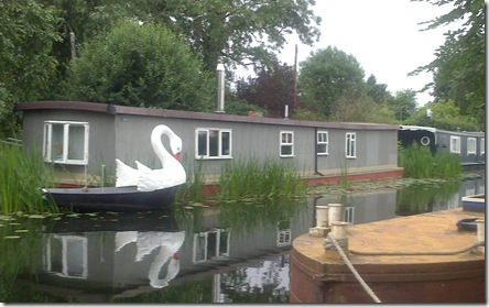 houseboat with swan dinghy