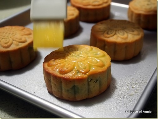 Brushing egg wash on traditional mooncake