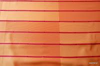"""Butikowa tkanina typu """"tafta"""". W pasy. Na zasłony, poduszki, narzuty, dekoracje. Trudnopalna. Pomarańczowa, brzoskwiniowa."""