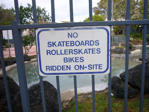"Two words would make this sign an actual English sentence.  Try: ""No skateboards, roller skates or bikes may be ridden on sight.""  I have sis more words: This sign blocks a great view."