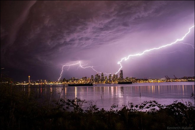 Lightning over Seattle on 10 August 2013. It's the warm and muggy nights that have not only brought a few nights of thunderstorms to the area but also primed Seattle to shatter its record for warmest August nights. Photo: Kenneth Malone