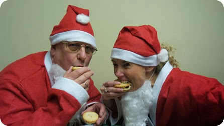 Preparing for the eating challenge. Santas Alan Barker, of  the hospice lottery team and Clare Dale of the hospice's fundraising team 2
