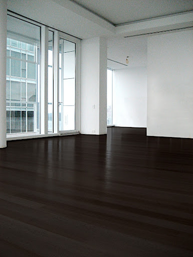 The apartment came with dark wenge floors, which I immediately knew would show every speck of dirt and dust and quickly fade with the floor-to-ceiling windows.  I knew they had to change.