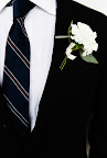 The groom wore Daniel Cremieux for Dillard's, and the boutonniere was created by contributing editor Matthew Robbins.
