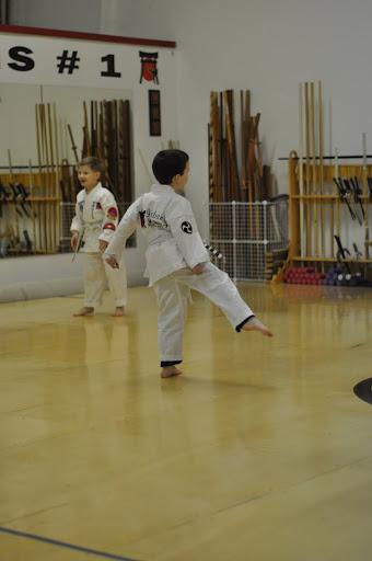 Eli practicing his kicks