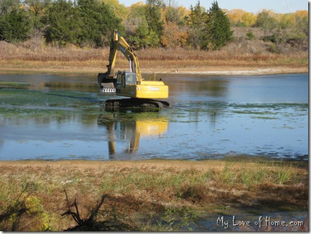 Backhoe in lake