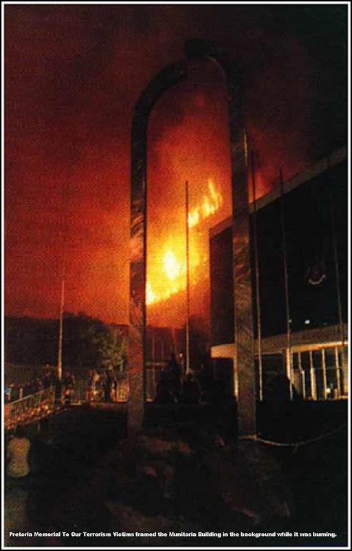 PretoriaTerrorismVictimMemorialPIC4withMUNITORIAbuildingOnFire1997
