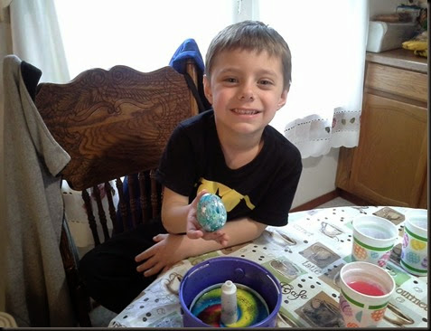 Aidan coloring eggs