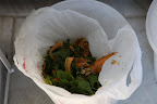 Oh, excellent!  It holds all of the fruit and vegetable scraps.  Before, we just had pails with no covers.  These are much nicer.