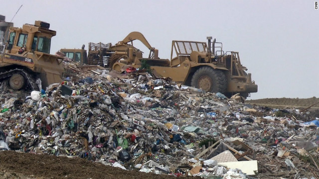 Compacting trucks assemble the latest delivery to L.A.'s Puente Hills Landfill, the largest rubbish dump in America. Despite surface appearances, Puente Hills is considered one of the most state-of-the-art landfills in the world. Some aren't so well maintained. CNN