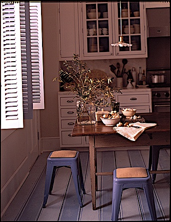 The alternating blue painted floor planks in this kitchen were inspired by a 19th Century dhurrie rug from India.