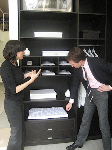 She explains the closet system and storage options.