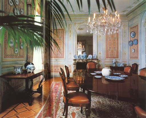 The dining room at the villa at Cap Ferrat combines quite a few of my loves: antique blue and white porcelain objets, a 19th-century Persian rug, and an antique crystal chandelier.