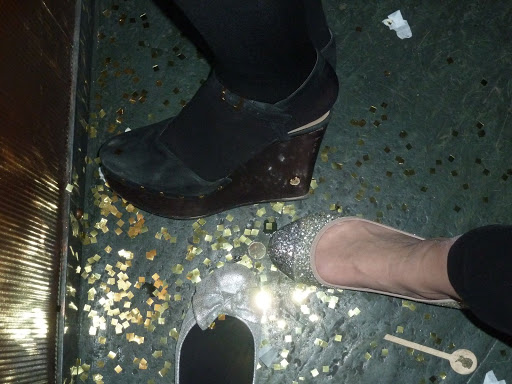 Me, Naomi, and Lauren with our festive feet and leftover confetti.