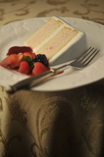 Take a look at the inside of the confection: ThisTahitian vanilla cake, with alternating layers of strawberry mousseline and French vanilla, is finished off with meringue buttercream and gray Swiss fondant.