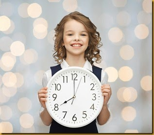 smiling girl holding big clock