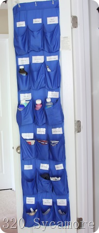 shoe organizer on back of linen closet for medicine storage