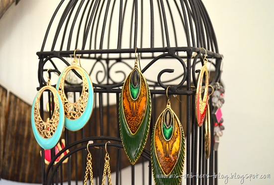 use a birdcage to hang earrings