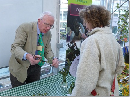Reaseheath lecturer Harry Delaney (left) offers fruit growing advice to a visitor