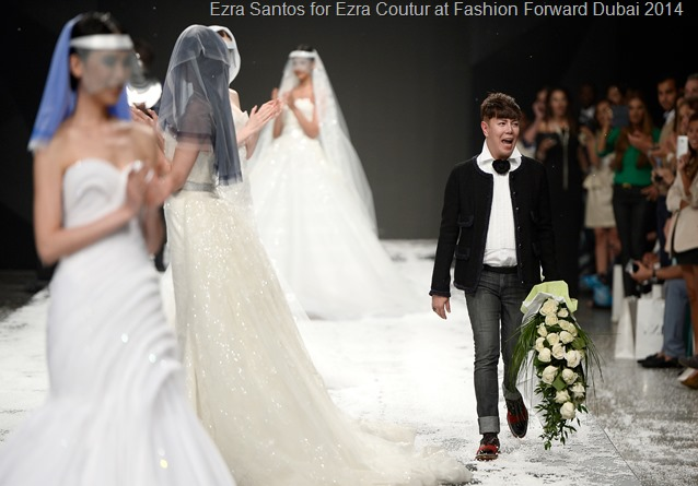 DUBAI, UNITED ARAB EMIRATES - APRIL 11: Designer Ezra walks the runway for the Ezra show finale during Fashion Forward at Madinat Jumeirah on April 11, 2014 in Dubai, United Arab Emirates.  (Photo by Ian Gavan/Getty Images for Fashion Forward)