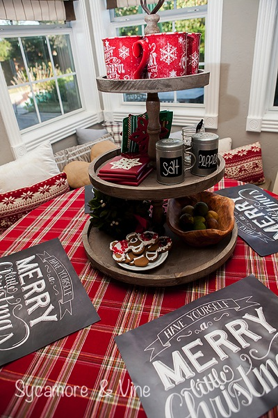 Hot Cocoa Bar on a wooden 3 their stand. A truly stunning Christmas Home Tour as part of the Christmas in the Country Blog Tour. This Plaid Inspired Country Christmas will knock your socks off. Features tours of the Living room, Dining Room and a Cocoa hot chocolate bar in the Breakfast room. There is so much inspiration for Christmas decorations in this one post. Be prepared to feel like you are cuddled up by the fire in a warm Northwoods comfy cottage! #country #Christmas #Plaid #Holiday decorating #Holiday ideas #Holidays #Christmas decor #Holiday decor