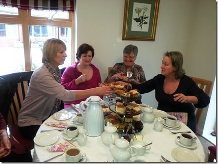 St Luke's (Cheshire) Hospice volunteers get in the spirit ahead of the Great Hospice Bake Off 2013