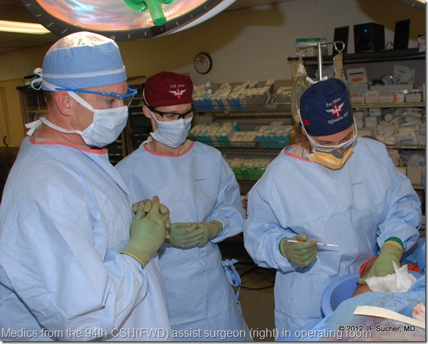Medics from the 94th CSH(FWD) assist surgeon (right) in operating room