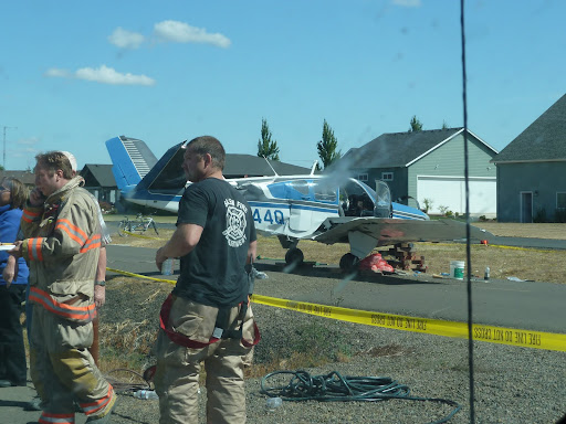 A quick snapshot through the dirty window of my car as the emergency personnel were motioning me through the area. This was a runaway plane incident with this Bonanza. I don't believe anybody was hurt, fortunately, but it sure trashed the plane.