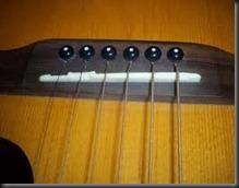 guitarra acustica puente cuerdas metal