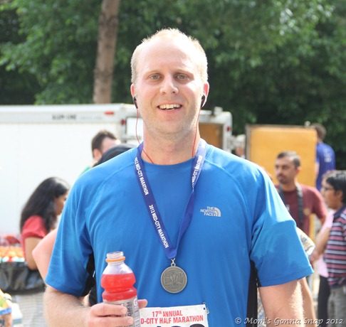 He looks pretty good for just running 13.1 miles in extremely hot weather!