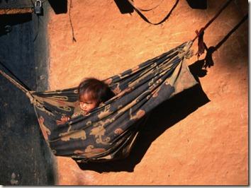 Gareth-McCormack-Tharu-Child-in-Hammock-Near-Karnali-River-in-Western-Nepal-Karnali-River-Bheri-Nepal