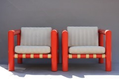 Pair of lounge chairs with orange tubular acrylic frames
