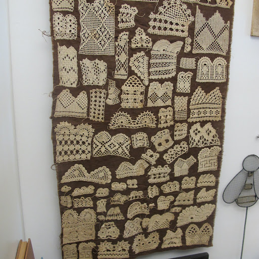 Fritz uses this vintage crochet sampler from the late 19th century as a wall hanging.