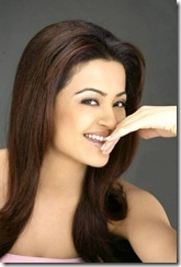 Surveen Chawla Hot Smile