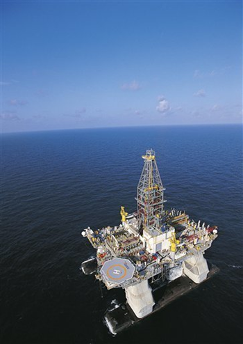 In this undated file photo released by Transocean, the ultra-deepwater semi-submersible rig Deepwater Horizon is shown operating in the U.S. Gulf of Mexico. AP Photo / Transocean