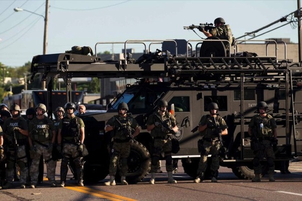 CC Photo Google Image Search Source is pbs twimg com  Subject is militarized police