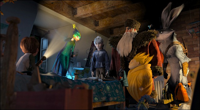 (Left to right)         Jamie (Dakota Goyo) awakens to find The Guardians—Tooth (Isla Fisher), Jack Frost (Chris Pine), North (Alec Baldwin), Sandman and Bunnymund (Hugh Jackman)—in his bedroom in DreamWorks Animation's RISE OF THE GUARDIANS to be released by Paramount Pictures.