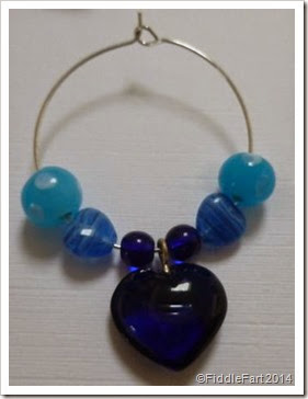 Beaded glass wine charm.